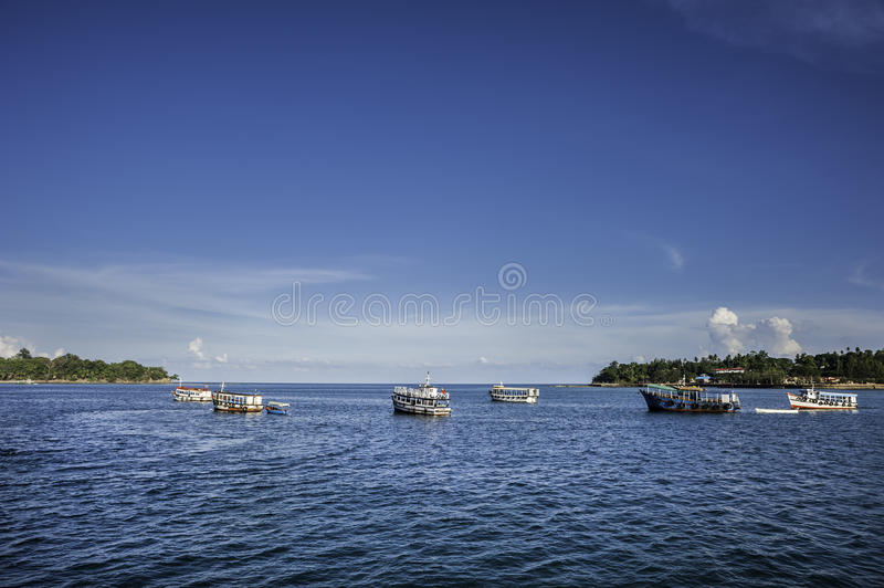 Boats on the sea. Boats are waiting for their passengers near Port Blair harbor in Bengal Bay, India stock images