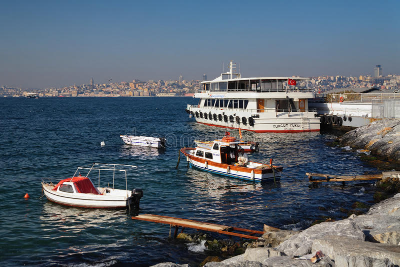 Boats and ship at the Bosphorus coast royalty free stock photography