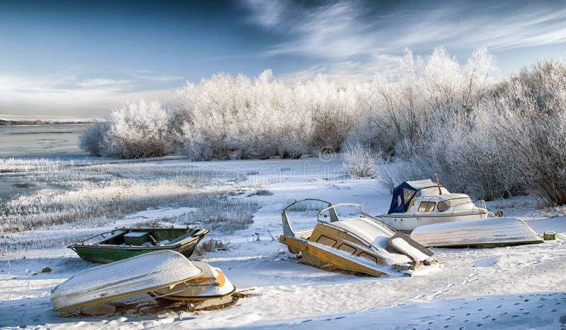 Boats on shore at lake Liptovska Mara, Slovakia royalty free stock image