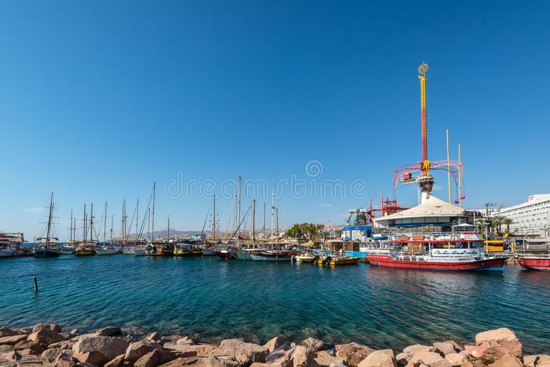 Boats and Spiral Park in Eilat, Israel royalty free stock image