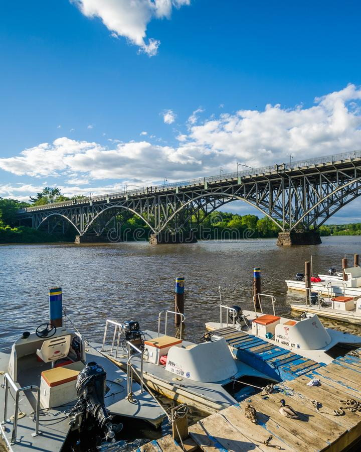 Boats and the Strawberry Mansion Bridge over the Schuylkill River, at Fairmount Park in Philadelphia, Pennsylvania.  royalty free stock images