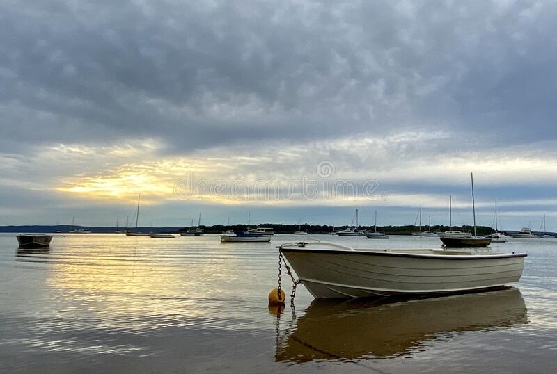 Boats between islands during a sunrise storm near Brisbane, Australia. Boats at sunrise between islands on Redlands Coast near Brisbane, Australia royalty free stock photos