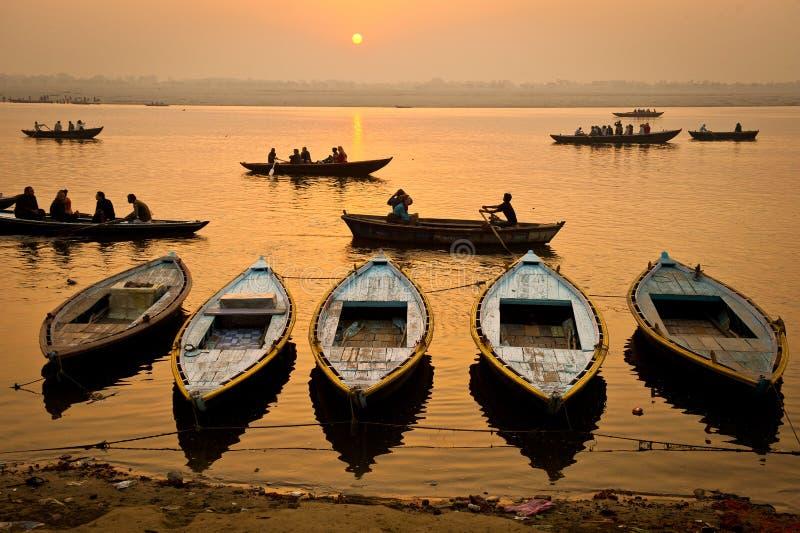 Boats in the sunrise - Varanasi, India royalty free stock images