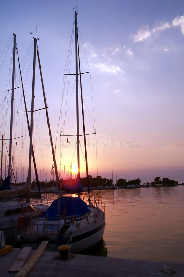 Boats at sunset royalty free stock image
