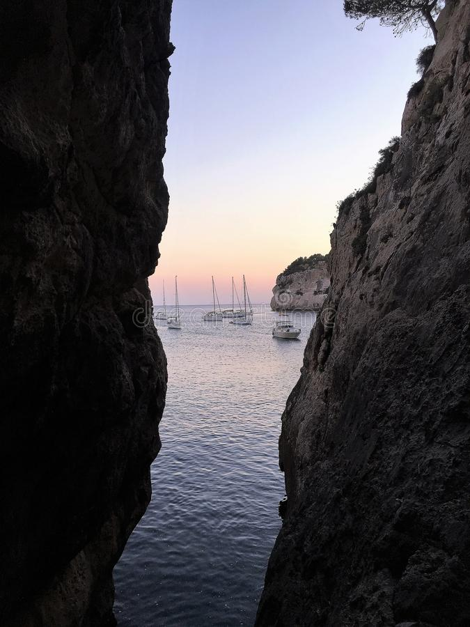 Boats at sunset in Menorca royalty free stock images