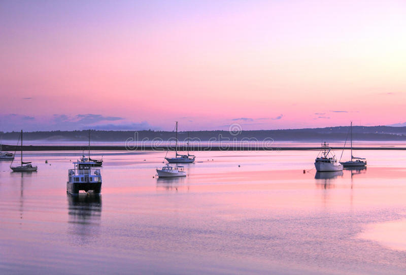 Boats at sunset, St. Andrews, New Brunswick royalty free stock photo