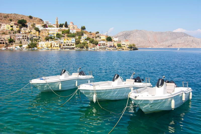 Boats in Symi town harbor, Dodecanese islands, Greece stock photography