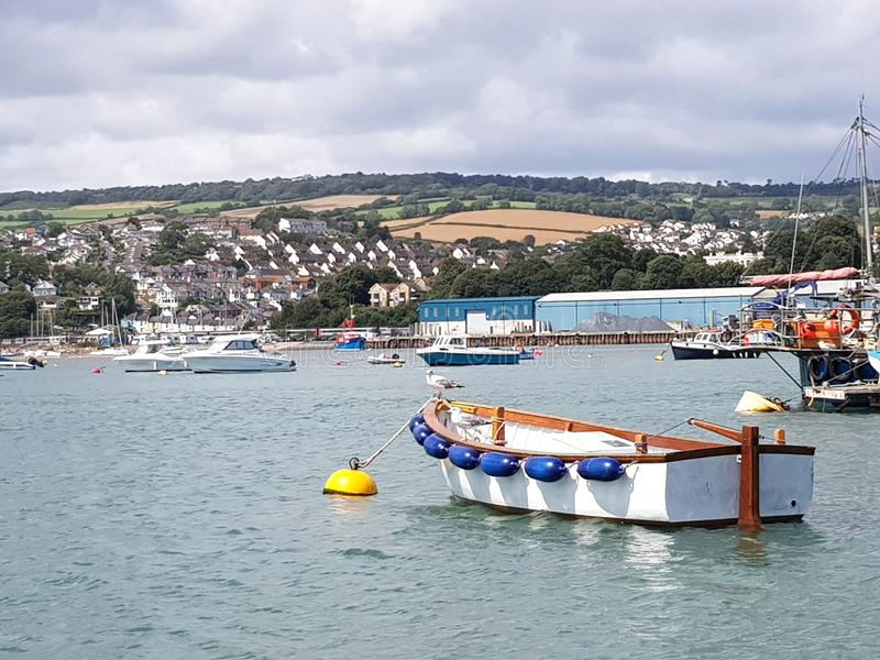 Boats in Teignmouth, Cornwall, United Kingdom. Port, harbout, harbour, nautical, vessel, seaguill, bird, beach stock photos