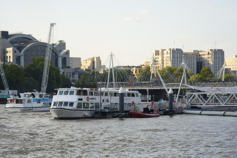 Boats on the Thames river in the evening. London, U.K royalty free stock images