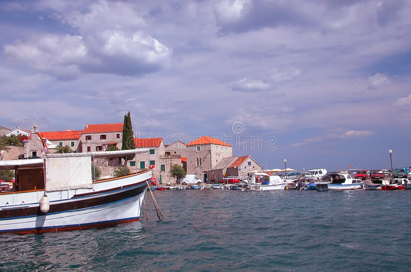 Boats tied at a harbor in Hvar stock photo