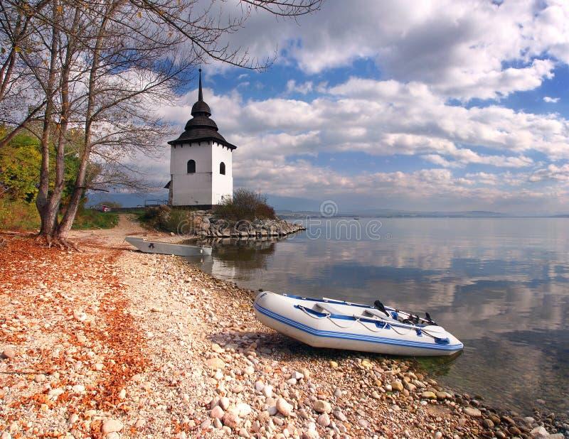 Boats and tower at Liptovska Mara, Slovakia royalty free stock image