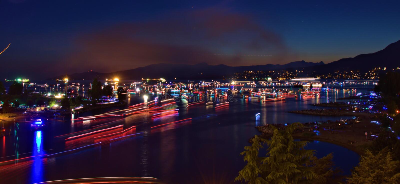 Boats travelling at night at Vancouver Canada. Boats are travelling at night at Vancouver Canada stock photo