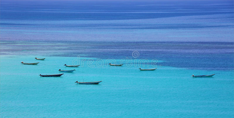 Download Boats At Turquoise Sea Royalty Free Stock Photo - Image: 31654595