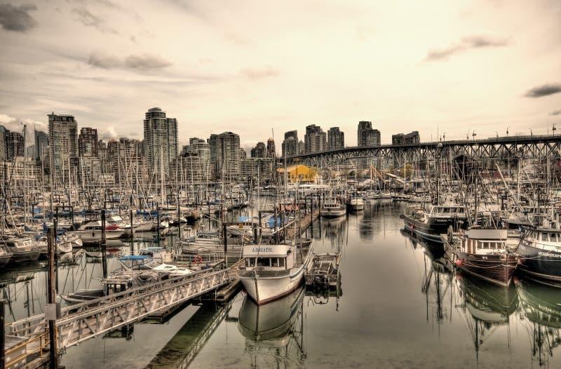 Boats in urban marina stock photo