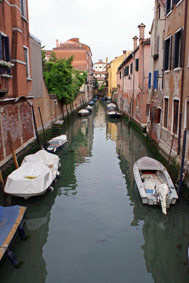 Boats on venice channel stock photos