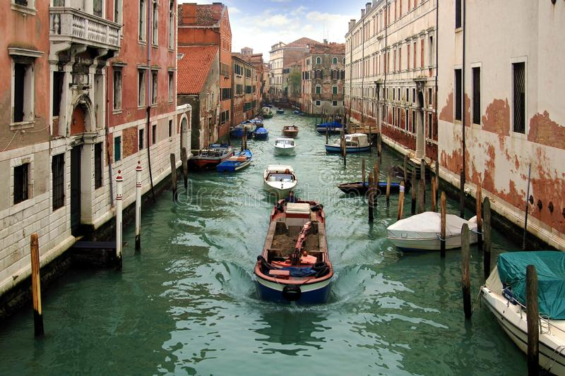 Boats in Venice. Differents boats sailing in the canals of Venice stock photos