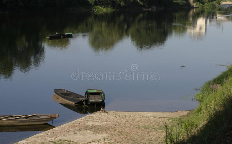 Boats on The Vienne River in Chinon France. Boats on the quayside royalty free stock photography