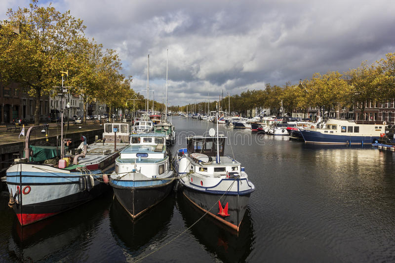 Boats in Vlaardingen in the Netherlands. On a sunny autumn day.nPhoto taken on: October 17th, 2014 royalty free stock photos