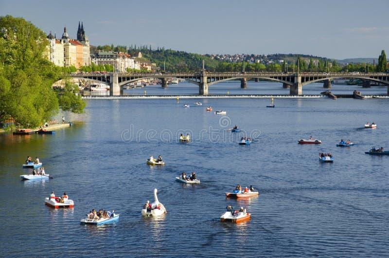 Boats on Vltava river, Prague stock photo