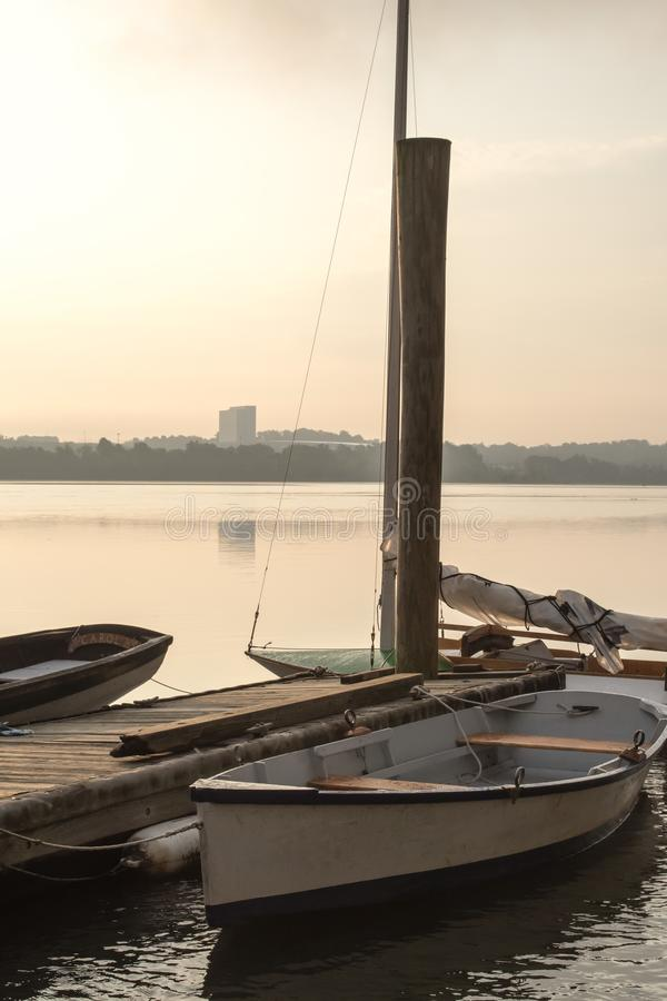 Boats wait in the morning mist along the Potomac river - Vertical Orientation royalty free stock photography