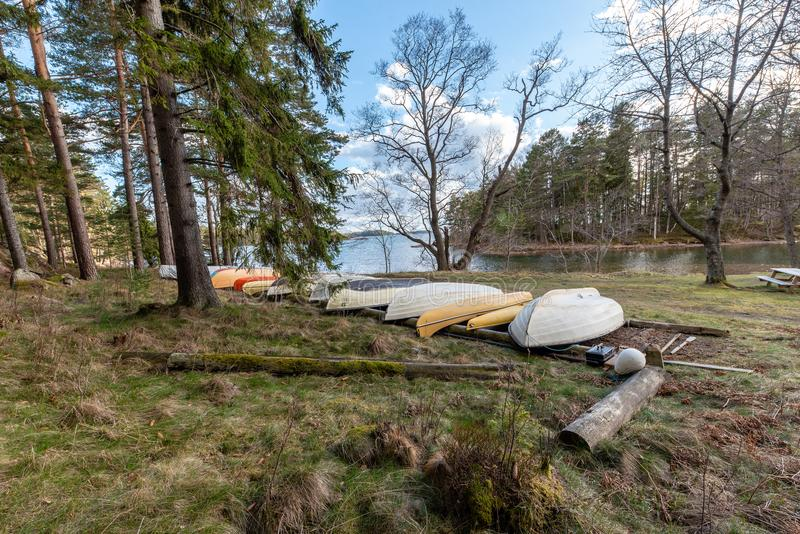 Boats waiting to be launched in to a lake stock image