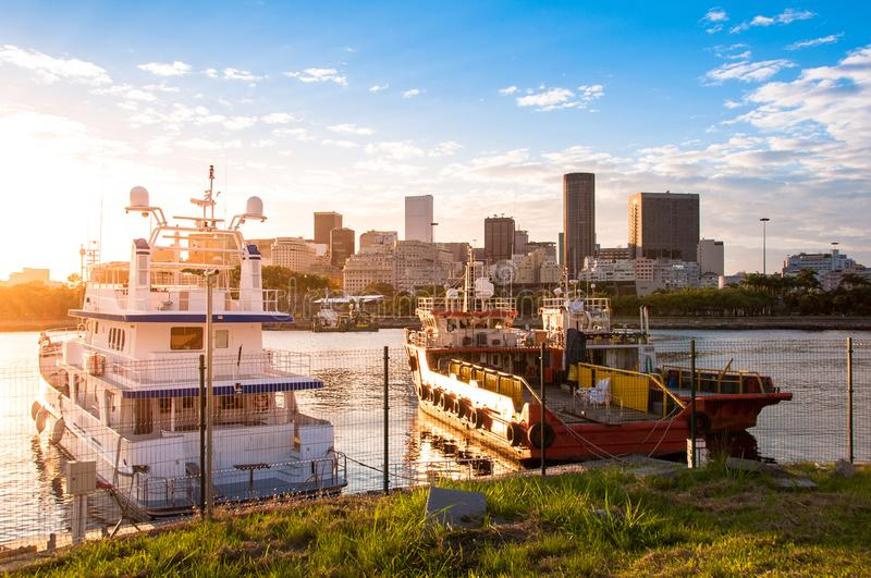 Boats in Water by Sunset. With Rio de Janeiro Downtown Skyline in the Horizon royalty free stock photos
