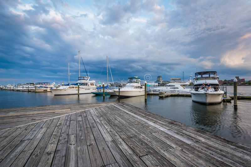 Boats on the waterfront at sunset in Fells Point, Baltimore, Maryland.  royalty free stock photo