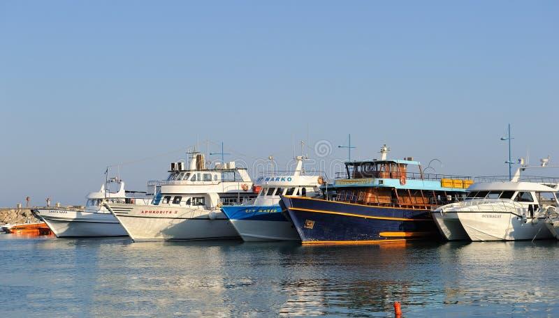 Boats and yachts at anchor in bay fishing stock image