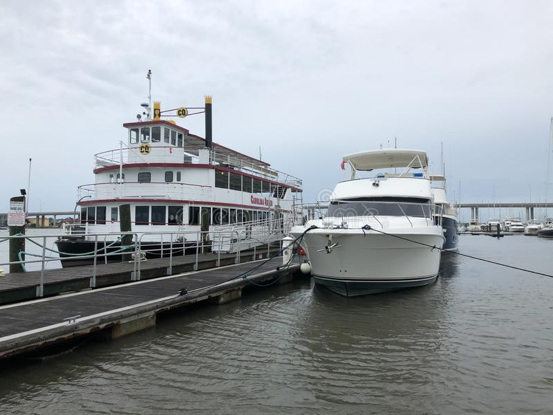 Boats and Yachts on the Ashley River are tied down for Hurricane Dorian. Boats and Yachts including the Carolina Queen are tied down for Hurricane Dorian royalty free stock photography
