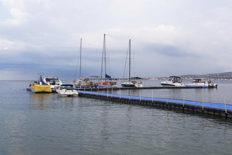 Boats and yachts at the floating pier in Gelendzhik Bay early summer morning royalty free stock photos