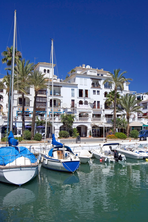 Boats and yachts moored in Duquesa port in Spain on the Costa de royalty free stock images