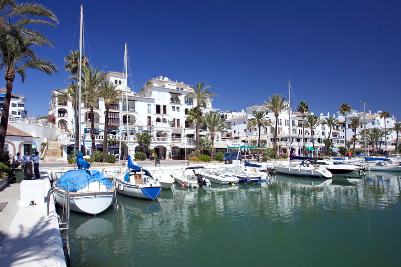 Boats and yachts moored in Duquesa port in Spain on the Costa de stock images