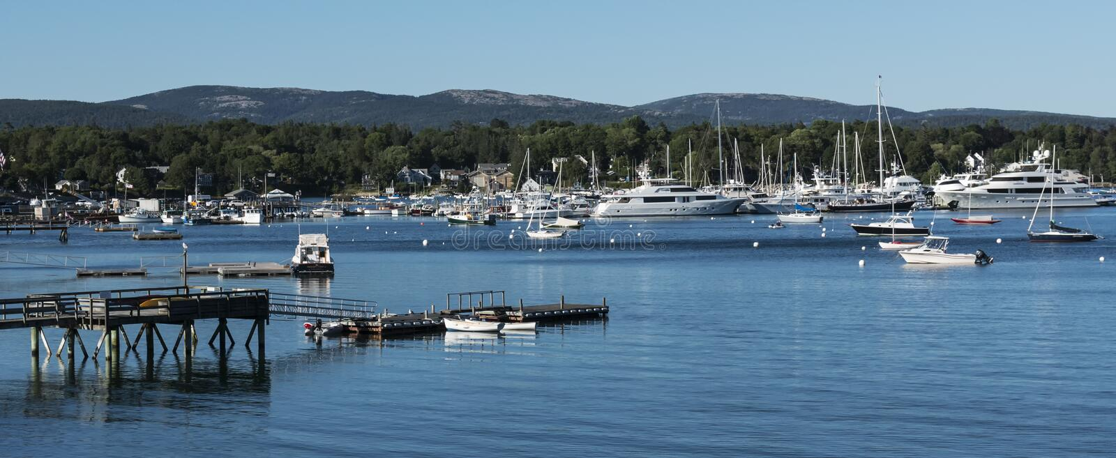 Boats and yachts moored in a harbor in Maine stock images