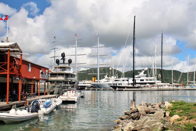 Boats and yahts docked - December 4, 2016 - boast and yachts docked at a Marina on the island of Antigua stock photos