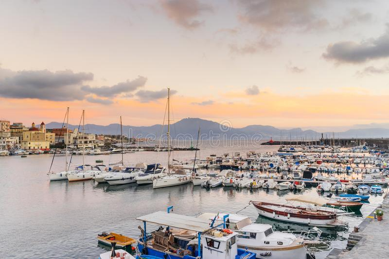 Boats and yatchs in the port of Torre del Greco in the gulf of Naples, on background Sorrento peninsula, Campania, Italy. Europe royalty free stock photo