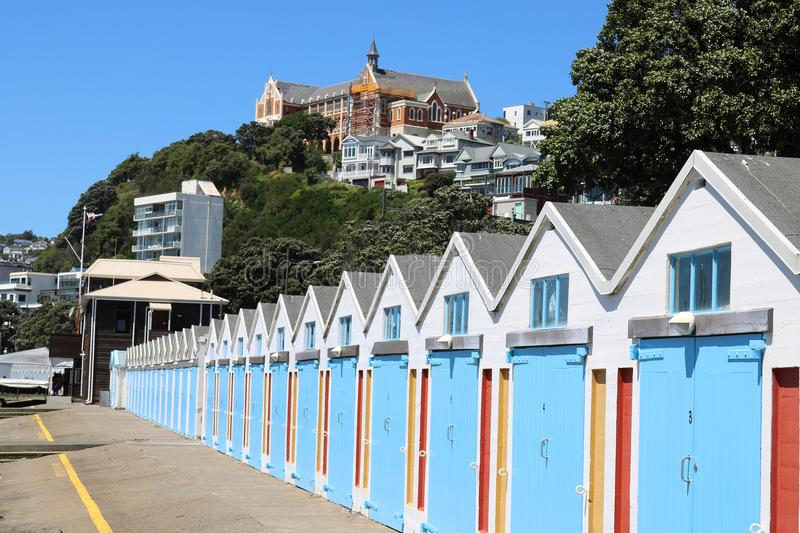 Boatsheds, Oriental Bay and St Gerard`s Monastery. View of the boat sheds on the side of Oriental Bay, Wellington, North Island, New Zealand with St Gerard`s royalty free stock photo