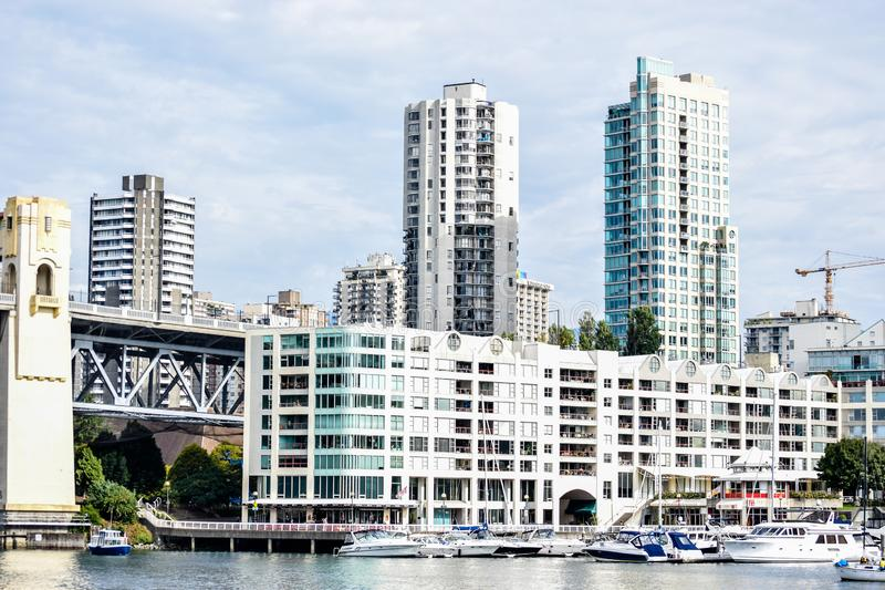 Boatyard with docked yachts and boats at the Burrard Bridge in Granville Island, Vancouver stock images
