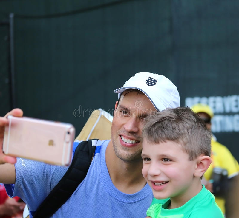 Bob Bryan of the Bryan Brothers takes a selfie with a young fan stock image