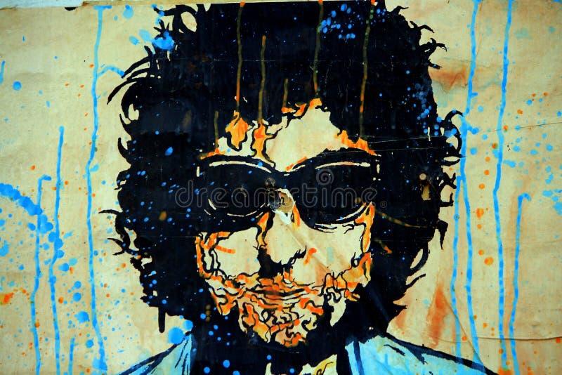 Bob Dylan graffiti art. Spray painted graffiti art of bob Dylan on a building exterior