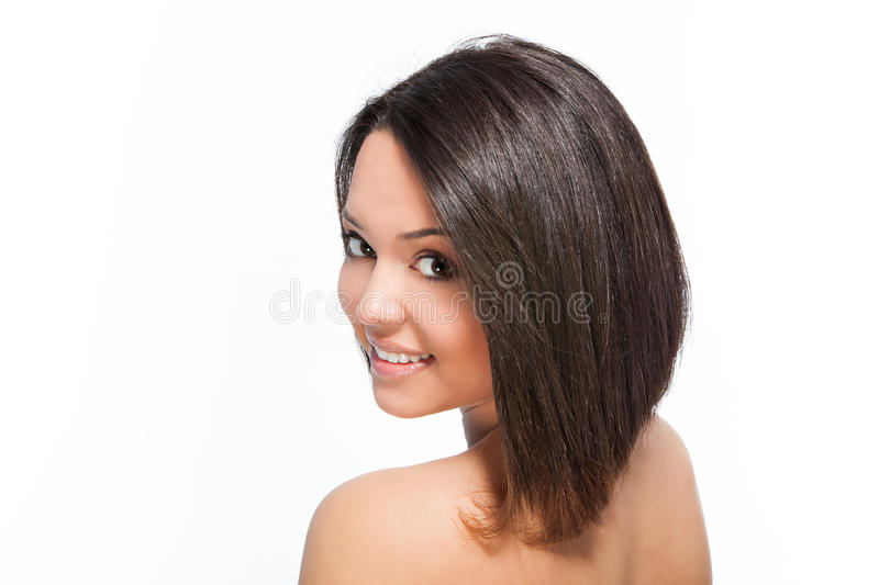 Bob hairstyle. Cute smiling young woman with bob hairstyle studio shot stock photography