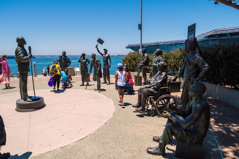 Bob Hope statue beside USS Midway aircraft carrier museum at the San Diego Harbor California. The USS midway is a retired aircraft carrier that served in the USA stock photography