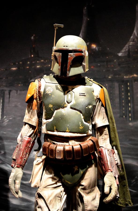 Boba Fett in front of Cloud City backdrop. Bounty Hunter Boba Fett from the original Star Wars trilogy, in a special exhibit at the Detroit Institute of Arts on stock photos