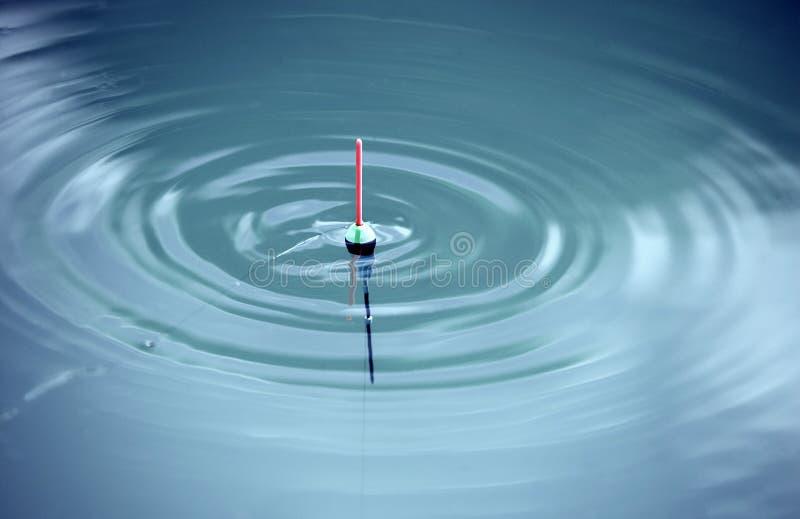 Bobber avec des ondes horizontales photo libre de droits