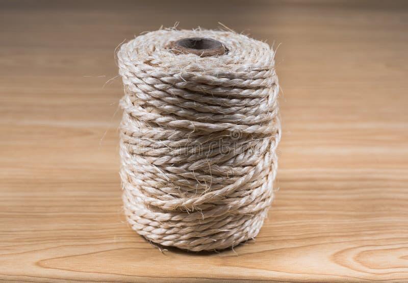 Bobbin of string of hemp stock photos