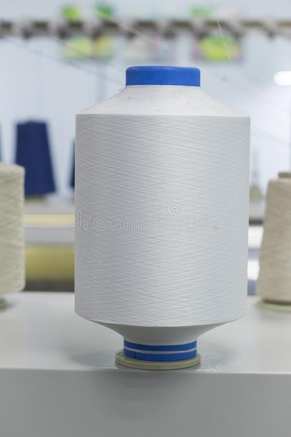 Bobbins with nylon thread, polyamide used for the manufacture of knitted clothing.  stock photo