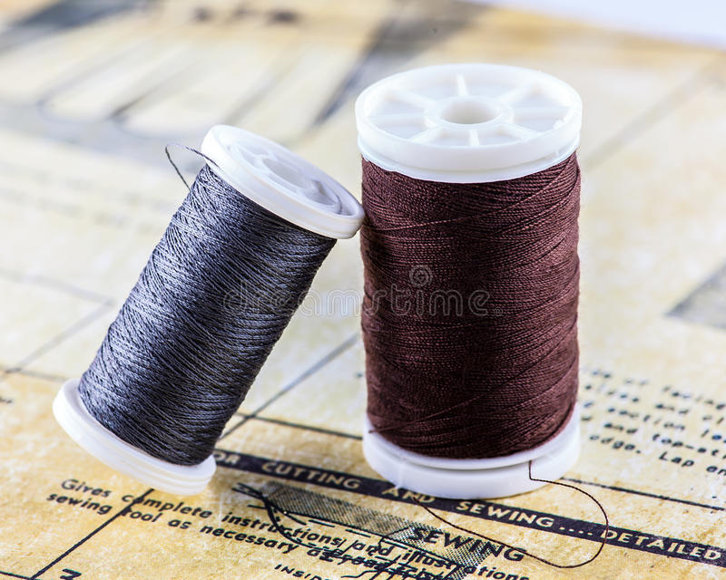 Bobbins and sewing instructions stock photography