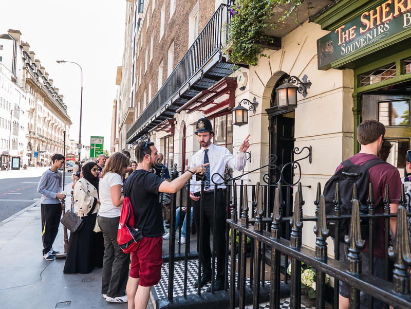 Bobby at door of Sherlock Holmes Museum, Baker Street, London, t. London, England, August 22, 2015: Bobby at entrance of Sherlock Holmes Museum, Baker Street stock images