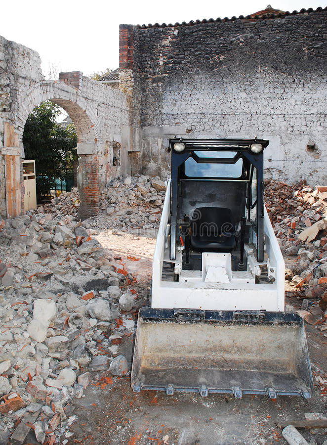 Download Bobcat Skid Steer Loader In Derelict Building Stock Image - Image: 15691793