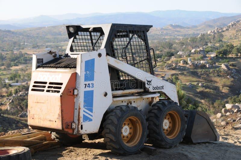 Bobcat Skid Steer Tractor Farm utrustning arkivbild