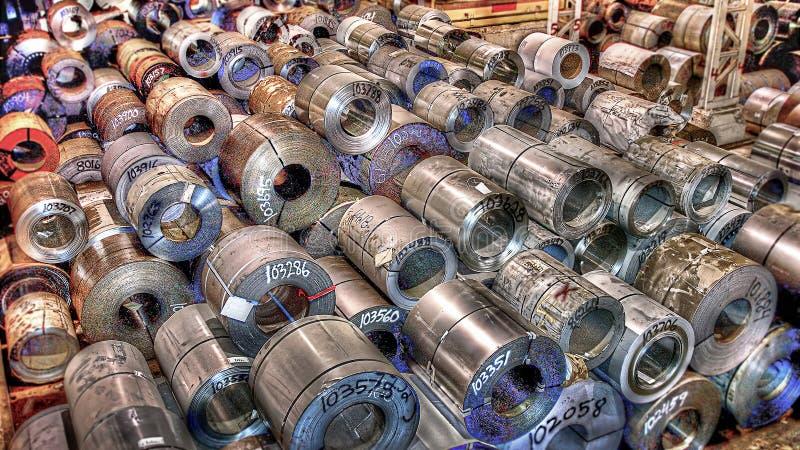 Bobina de aço no grande armazém fotografia de stock royalty free